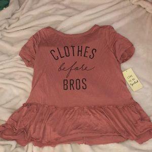 Pinkish shirt.